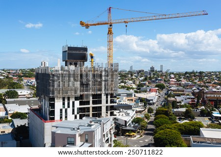 Australian construction site with screen system during the day (Brisbane, South Bank, QLD, Australia) - all logos removed - stock photo