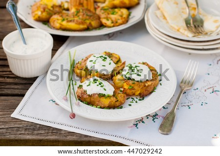 Australian Crash Hot Potatoes with Chives and Sour Cream and Herb Sauce, copy space for your text - stock photo
