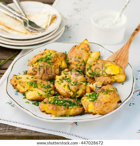 Australian Crash Hot Potatoes with Chives and Sour Cream and Herb Sauce, square - stock photo
