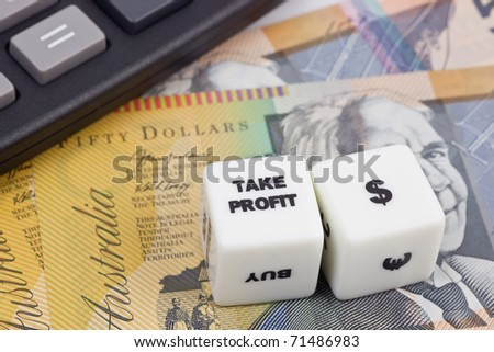 Australian currency with calculator and dice showing TAKE PROFIT - stock photo