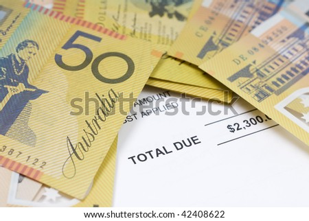 Australian fifty dollar bills randomly scattered on accounts notice. - stock photo
