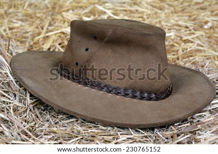 Australian hat on hay in a barn. - stock photo