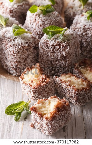 Australian Lamington cake decorated with mint close up on the table. vertical