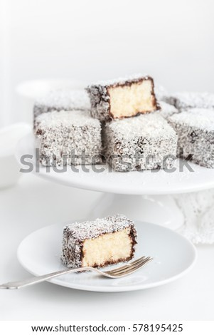 australian lamington cakes with chocolate and coconut. white background, selective focus