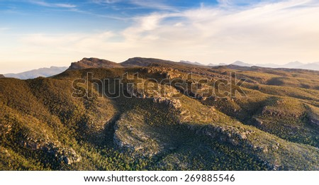 Australian mountains at sunset in the Grampians National Park, Victoria with rocky cliffs and valleys - stock photo