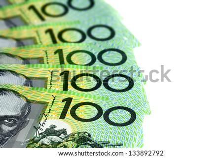 Australian one hundred dollar bills fanned over white background. - stock photo