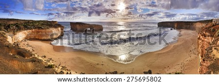 Australian's Great Ocean road national park - panoramic view of a bay with london bridge - disconnected landmass fragment eroded by strong open water waves - stock photo