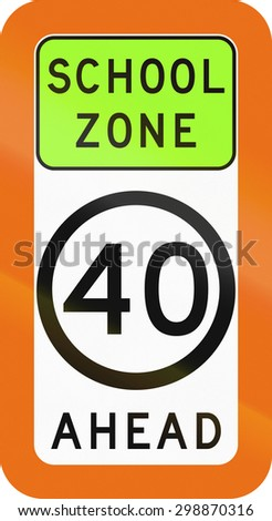 Australian school warning sign with speed limit ahead.