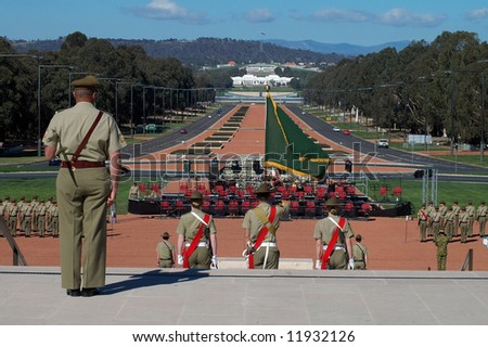 australian soldiers standing in front of australian war museum in Canberra, modern Parliament House in background, Anzac Parade - stock photo