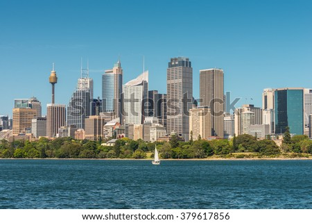 Australian Sydney landmark - city CBD high rises and towers forming megapolis cityscape summer day from harbour. The yacht in the foreground. - stock photo