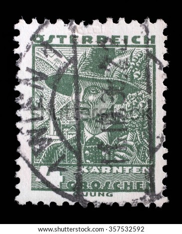 AUSTRIA - CIRCA 1934: A stamp printed by AUSTRIA shows Man from Carinthia, Traditional folk costume, circa 1934. - stock photo