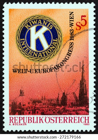 AUSTRIA - CIRCA 1983: A stamp printed in Austria issued for the World and European Conference of Kiwanis International, Vienna shows Kiwanis Emblem and View of Vienna, circa 1983. - stock photo