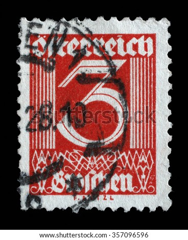 AUSTRIA - CIRCA 1925: A stamp printed in Austria shows image of the number 3, circa 1925. - stock photo