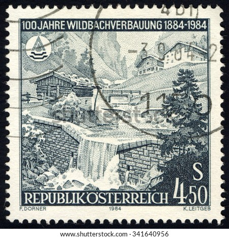 AUSTRIA - CIRCA 1984: A stamp printed in Austria to commemorate Torrent Control shows Stone Reinforcement Wall in Mountain Torrent, circa 1984