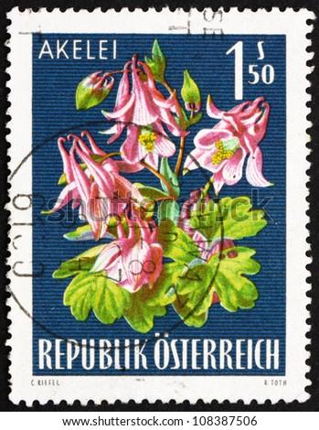 AUSTRIA - CIRCA 1966: a stamp printed in the Austria shows Columbine, Alpine Flower, circa 1966 - stock photo
