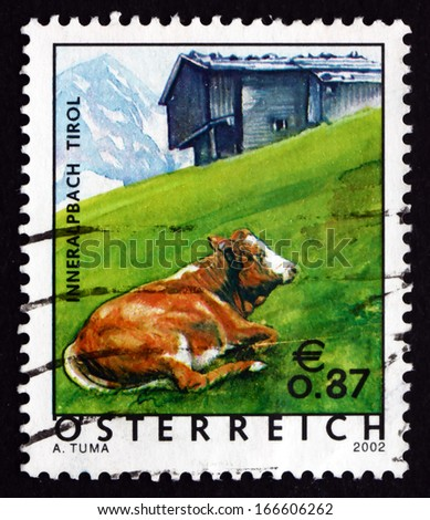 AUSTRIA - CIRCA 2002: a stamp printed in the Austria shows Cow in Pasture, Tyrol Province, circa 2002 - stock photo
