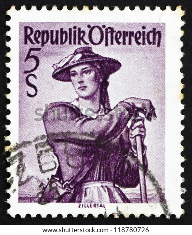 AUSTRIA - CIRCA 1948: a stamp printed in the Austria shows Woman from Ziller Valley, Regional Costume, circa 1948 - stock photo