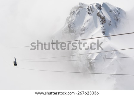 Austria: Dachstein protrudes from the clouds - before cable - stock photo