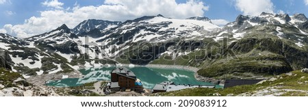 Austria, Salzburg, Kaprun: water reservoir  for electricity production on 2500m altitiude at the Weisse See (white lake) - stock photo