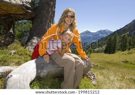 Austria, Salzburger Land, mother and daughter taking a break - stock photo