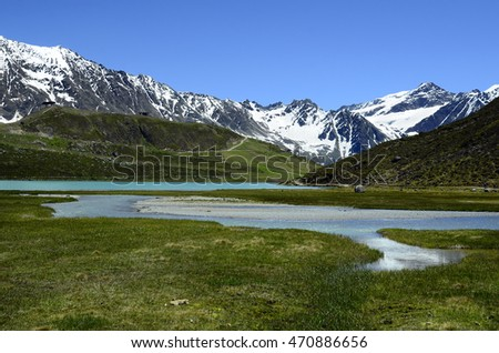 Austria, Tirol, Rifflsee lake and snow remains in Austrian Alps in Pitztal