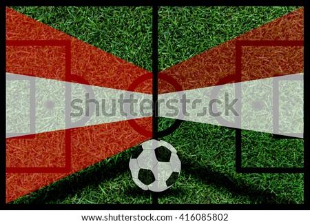 Austria vs Hungary football flag background on green pitch - stock photo