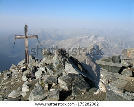 Austrian Alps, High Tauern National Park, mountain cross on top of the Ankogel - stock photo