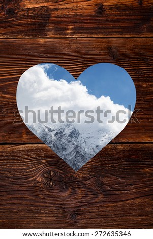 Austrian Alps in heart shape window on vintage wooden background. Snow covered mountain. Winter. - stock photo