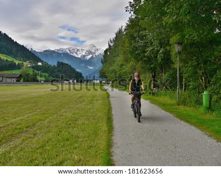 Austrian Alps-view on the cyclist to bicycle path in valley Zillertal - stock photo