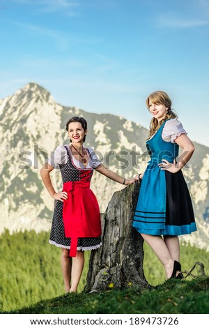Austrian Beauties with traditional clothes in the alps