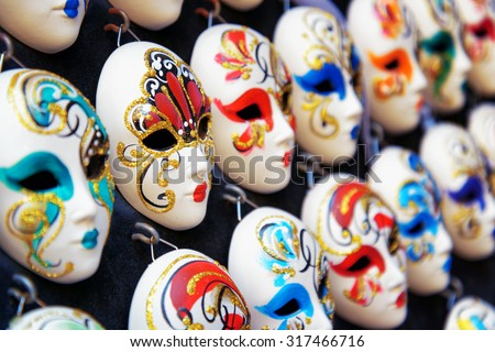 Authentic and original Venetian full-face masks for Carnival in street shop of Venice, Italy. Venice is a popular tourist destination of Europe. - stock photo