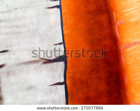 Authentic background painted concrete paint, weathered with cracks and scratches. Landscape style. Grungy concrete surface. Great background or texture. - stock photo