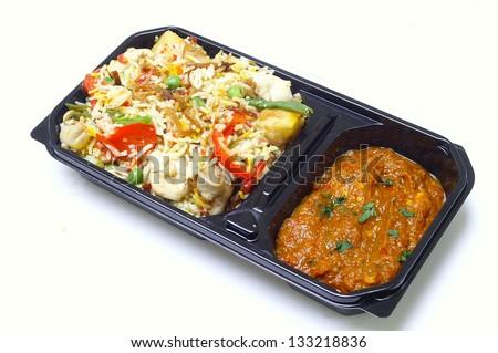 authentic biryani in takeaway tray - stock photo