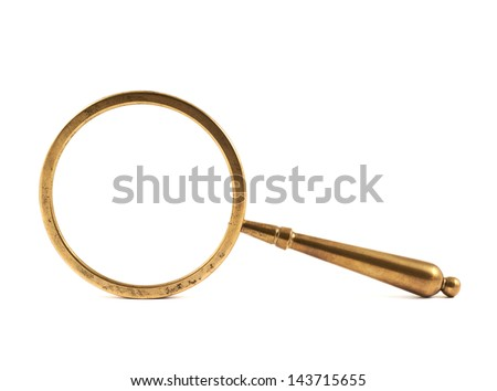 Authentic old metal magnifying glass isolated over white background
