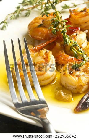 Authentic Portuguese Garlic Shrimp garnished with rosemary and thyme - stock photo