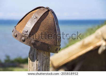 authentic restored viking helmet under the high midday sun - stock photo