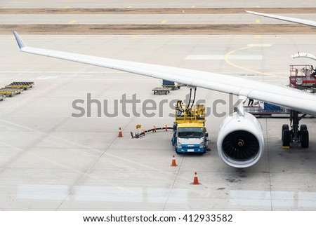 Authorities are fueling aircraft  before flying. - stock photo