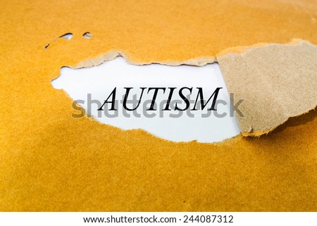 autism text concept on brown envelope  - stock photo
