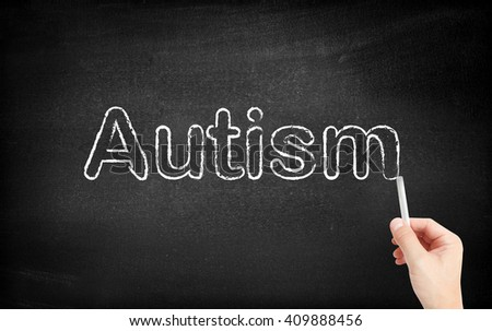 Autism written on white blackboard