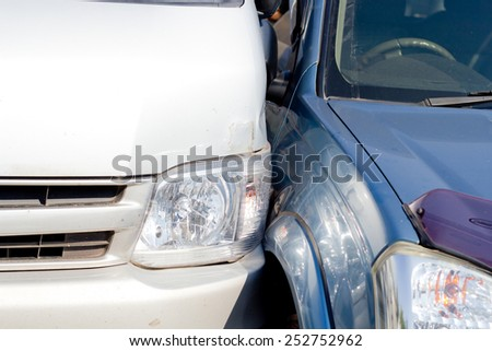 Auto accident involving two cars on a city street - stock photo