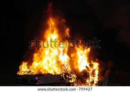 auto and flames - stock photo