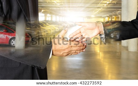auto business, car sale, deal, gesture and people concept - close up of dealer giving hand to new owner and shaking hands in auto show or salon - stock photo