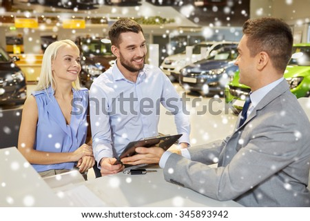 auto business, sale and people concept - happy couple with and dealer with clipboard buying car in auto show or salon over snow effect