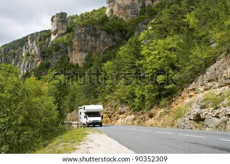 Auto Camper, motor home on road. - stock photo