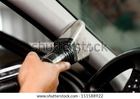 Auto car service cleaning car, cleaning and vacuuming leather - stock photo