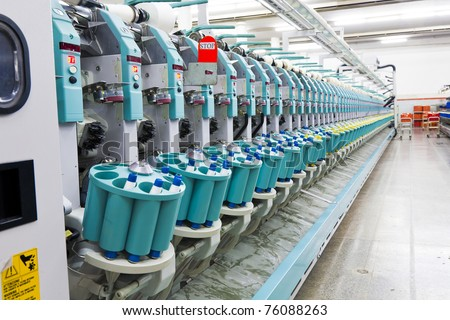 auto cone machine at a textile spinning mill - stock photo