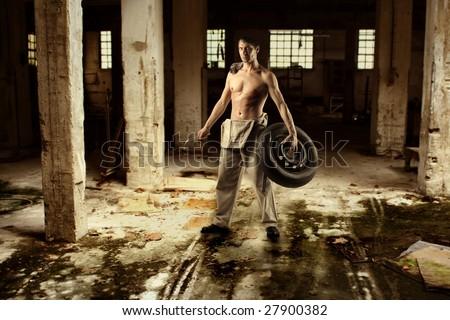 auto mechanic a dirty factory - stock photo