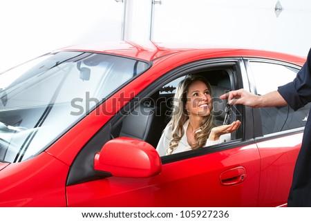 Auto mechanic and a client woman. Car repair service. - stock photo