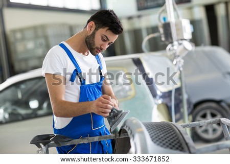auto mechanic  polished scratches on car - stock photo