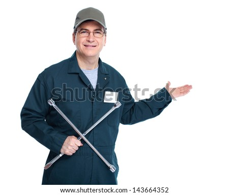 Auto mechanic with a wheel wrench. Isolated on white background. - stock photo